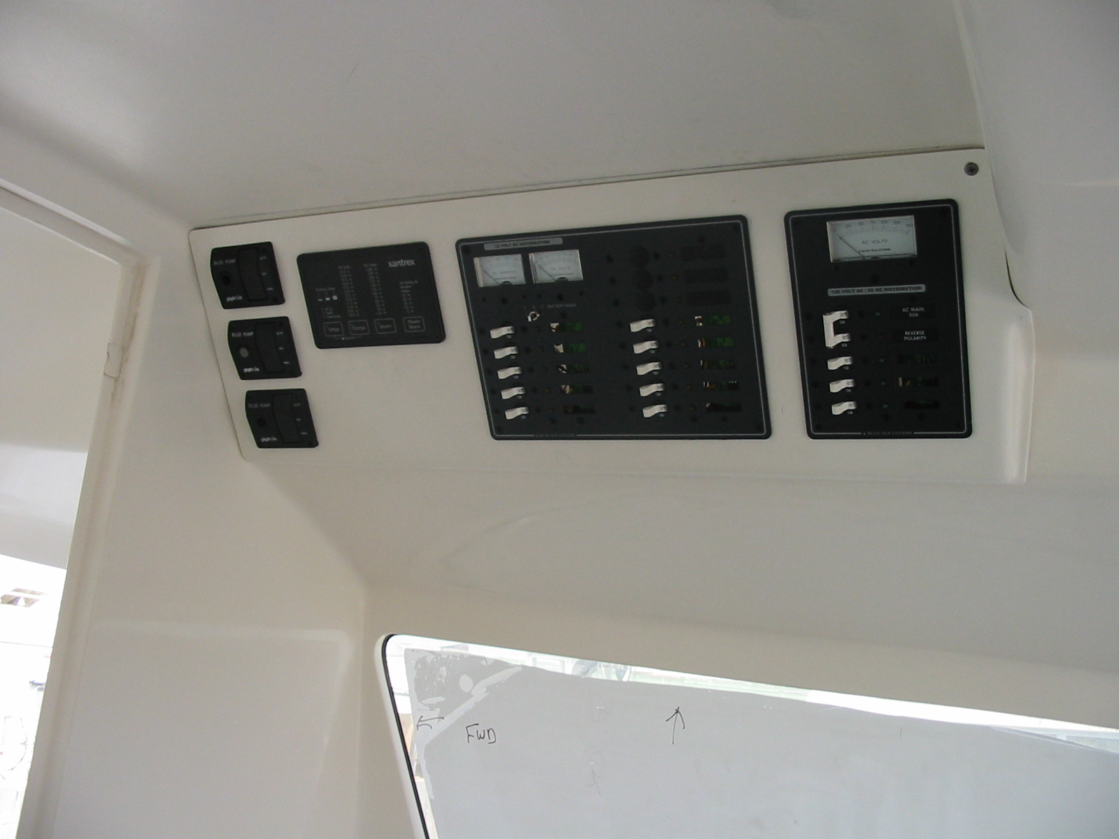 AC & DC electrical circuit breakers, cabin bilge pump controls, and inverter panel.