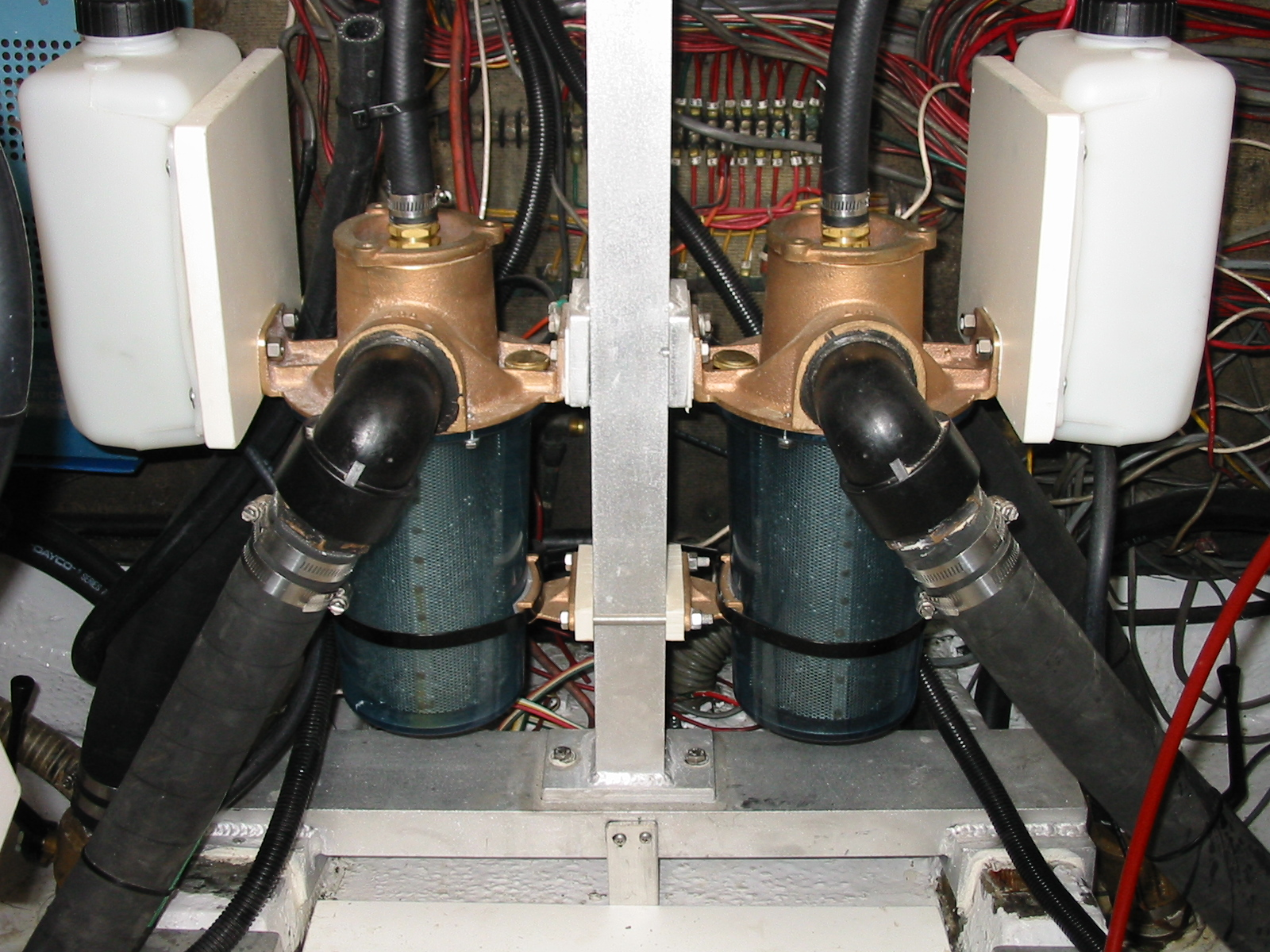 Sea strainers, deck support and coolant overflow bottles tucked in a small area.