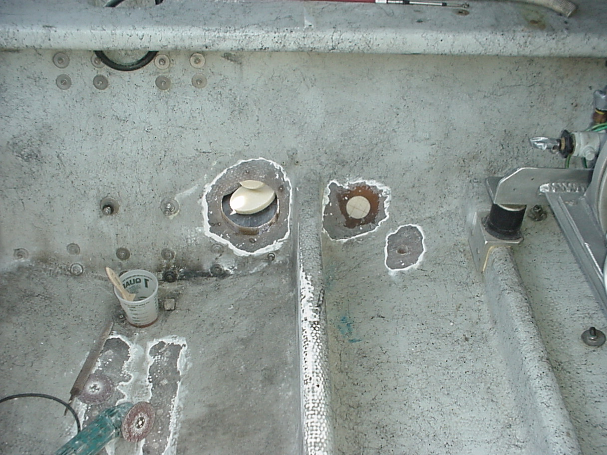 "The prep work inside the boat consisted of lots of grinding and patching of old holes (6"" exhaust and misc. shown at transom end)."