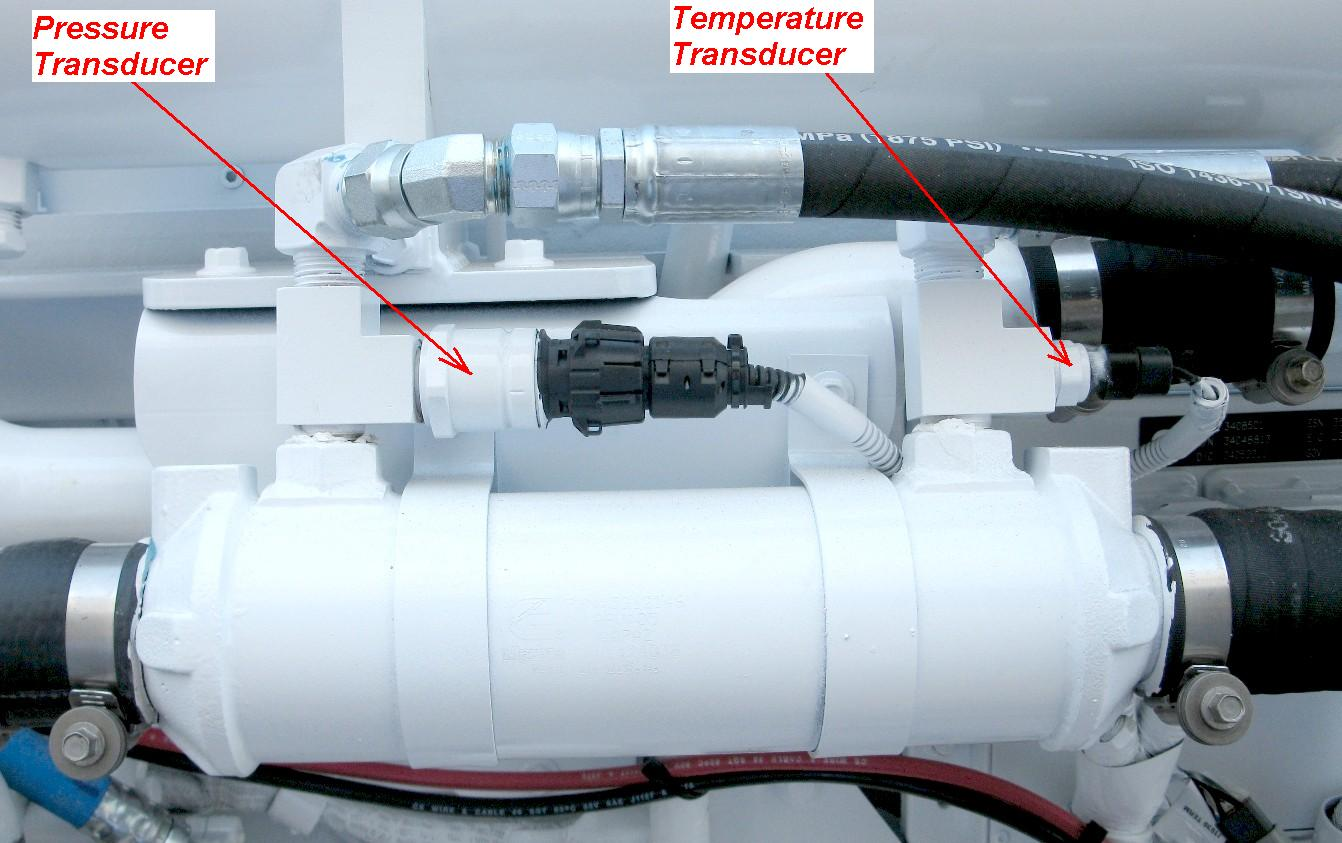 Oil cooler with transducers location