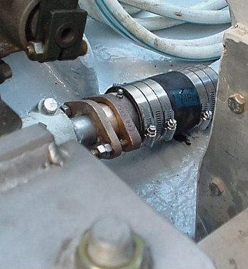"Not much room between the output of the transmission and the shaft log required a semi-custom packing. We re-machine the rough castings to be very accurate, install a SS zerk fitting, use PURE Teflon packing, and pre-run the assembly in on our lathe at 1800 SHAFT RPM. This makes for a trouble-free, ""commercial quality"" packing/shaft seal that is close to dripless and will last just about forever."